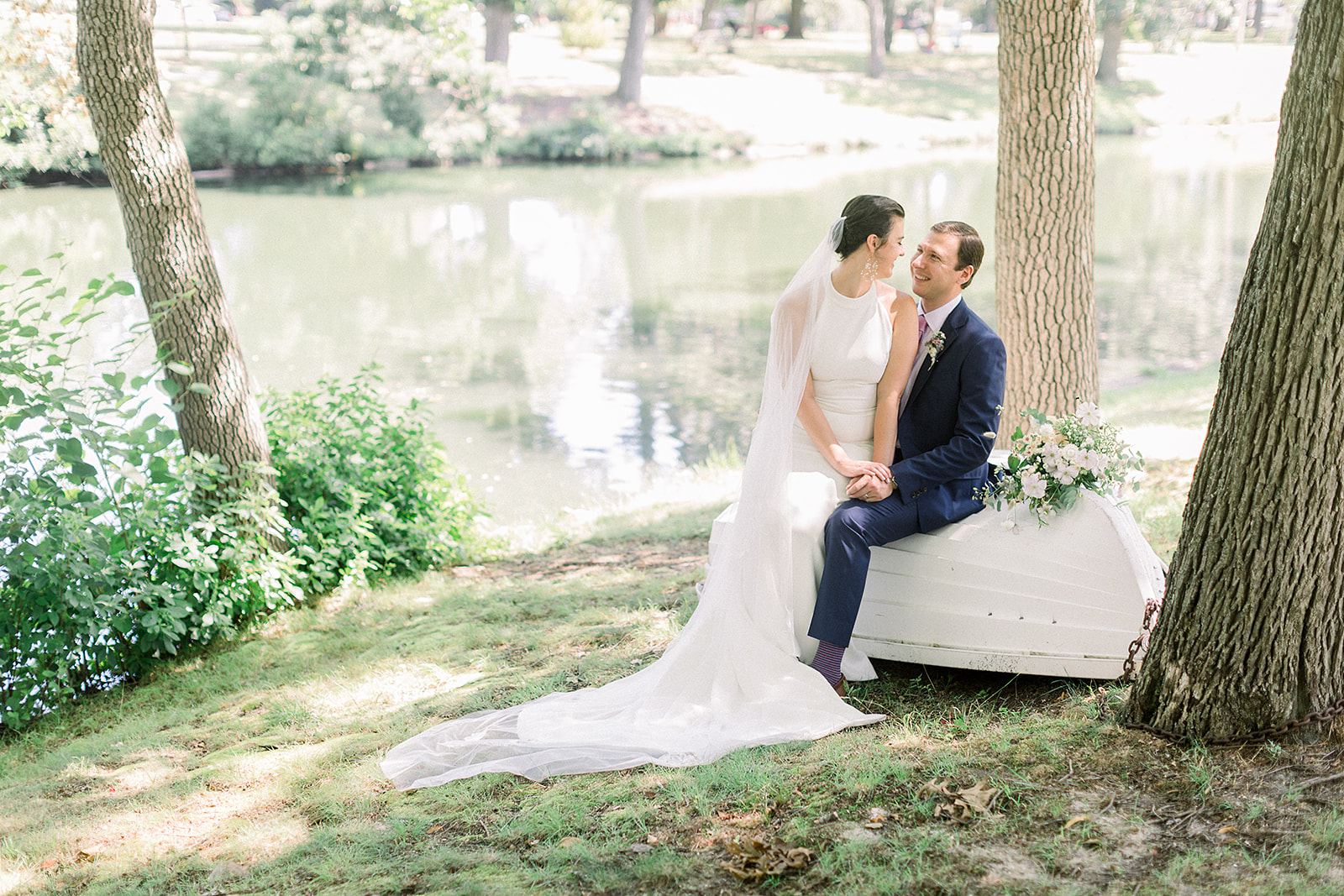 A room filled with furniture and vase of flowers next to a window - Bride